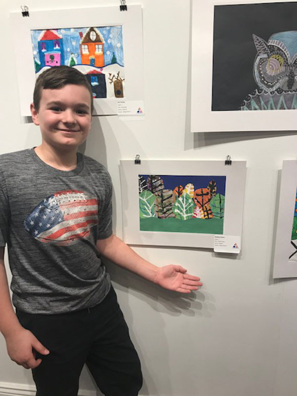 ES Student standing next to art at the Trumbull Art Gallery