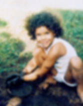 Designer Ilona as a child playing in the mud