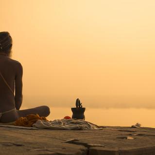 Indian Priest Meditation at Sunset