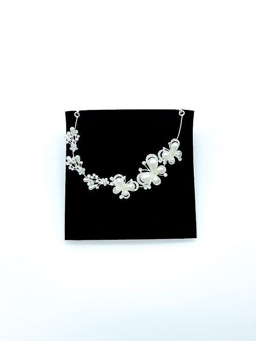 Decorazione acconciatura sposa con farfalle e perle