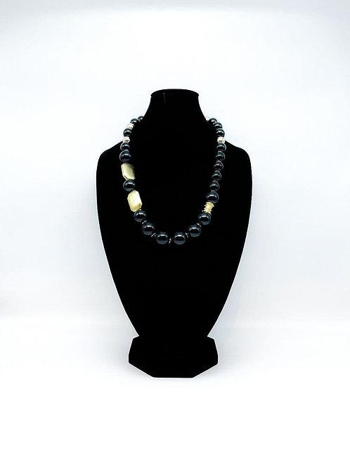 Collana lunga con perle nero/oro