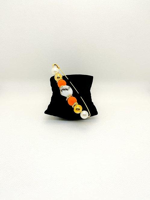 Spilla con perle e pietre arancioni