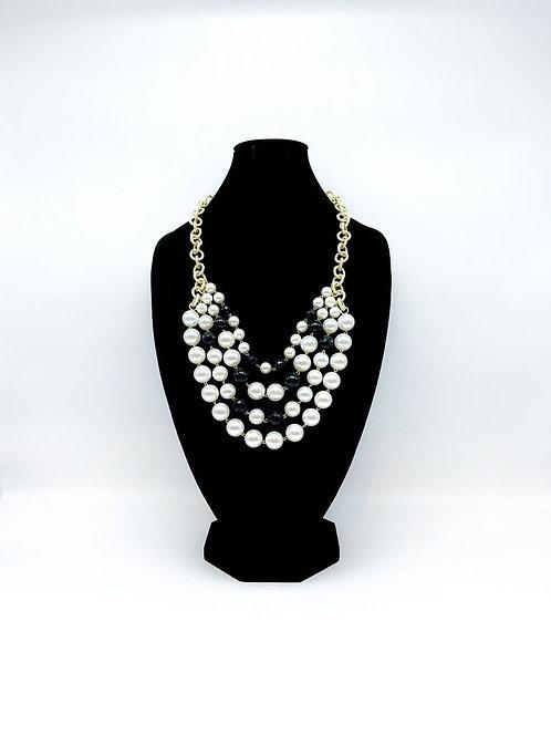 Collana lunga con perle bianco/nero