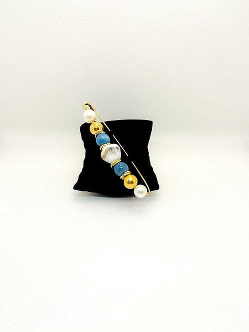 Spilla con perle e pietre blu