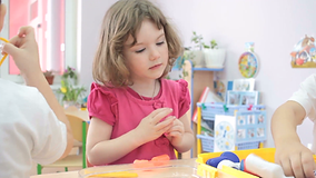 little-girl-playing-doctors-in-kindergar