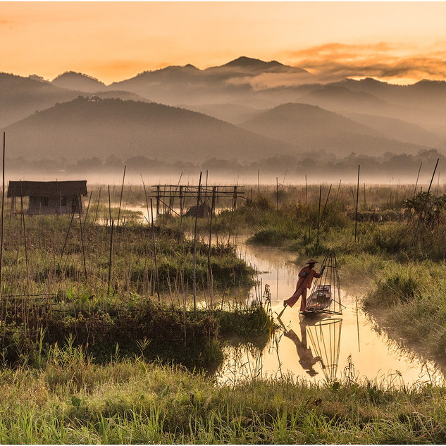 EARLY MORNING FISHERMAN IN THE FLOATING GARDENS