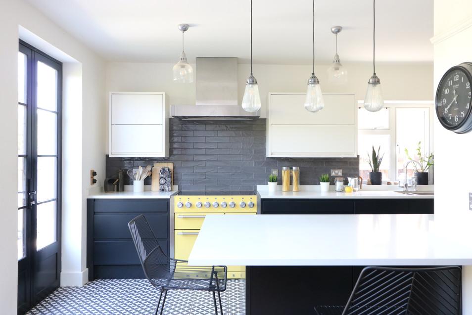 breakfast bar lighting in black and white kitchen