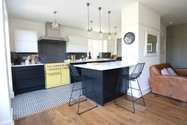Black and White Kitchen open plan into dining and seating area