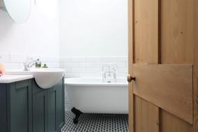 through the door into Victorian cottage bathroom