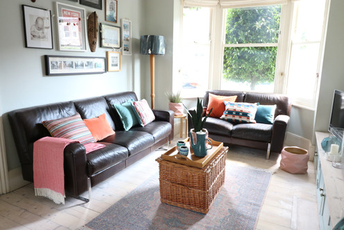 Light airy living room, teal and coral a
