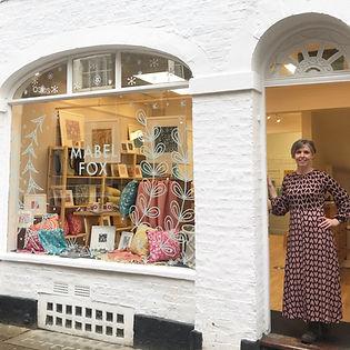 Katie at the shop door
