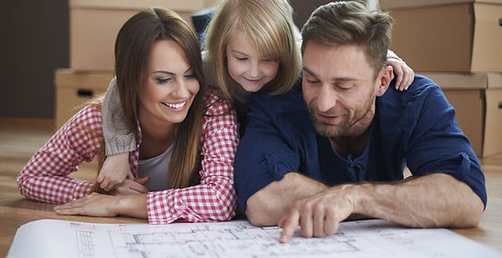 Family looking at floor plans