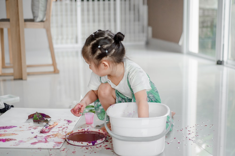 a toddler painting