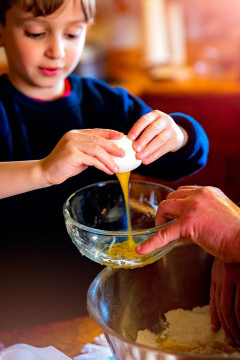 Children being taught to bake in preschool.