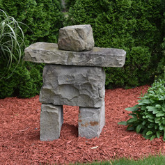 """This little """"rock man"""" keeps watch over the front of the garden"""