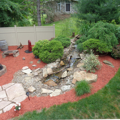 This gardner even placed a seating area and fit pit by her waterfall so that all of the guests could enjoy this feature