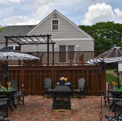 A beautiful deck and patio.  We're still not sure which one we envy more!