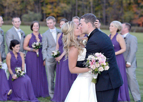 kiss with bridal party behind.jpg