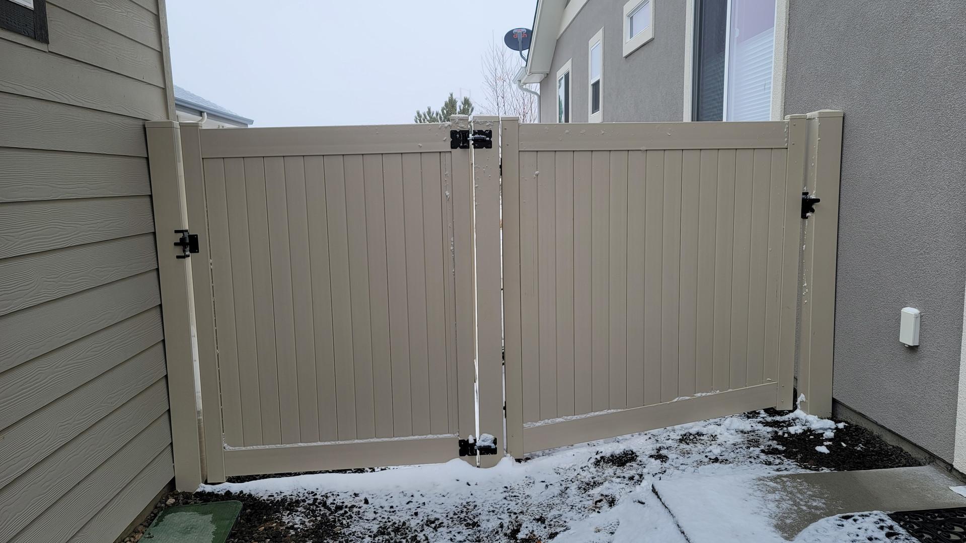 Vinyl Gates on a slope Tan Privacy.jpg