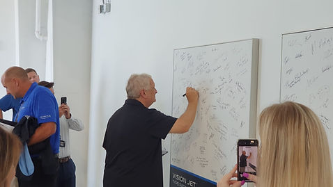 Signing the board.JPG