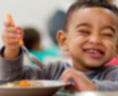 cute kid enjoying his food.jpg