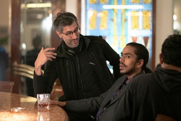 "Ramin Bahrani directing Adarsh Gourav in ""The White Tiger."""