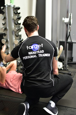 Personal Trainer helping a member