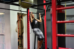 Personal trainer doing chin ups