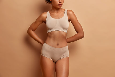 body-care-concept-dark-skinned-woman-wears-lingerie-ha-flat-belly-slender-legs.jpg
