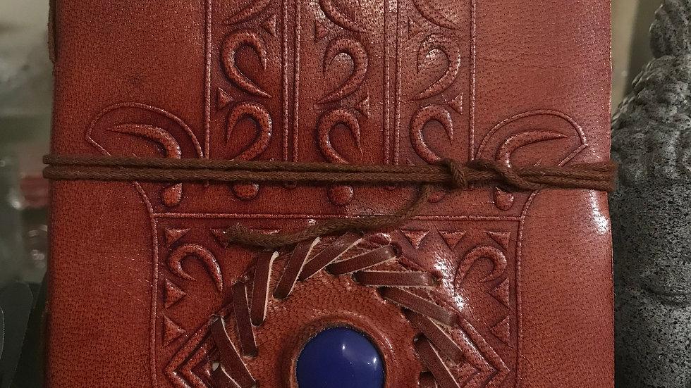 hamsa hand + blue stone leather journal + cord closure