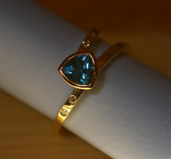 Ring with Trilliant & 4 Diamonds