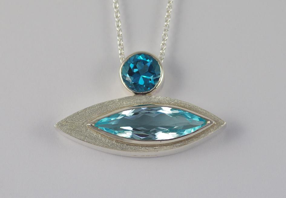 Pod pendant with 2 Blue Topaz