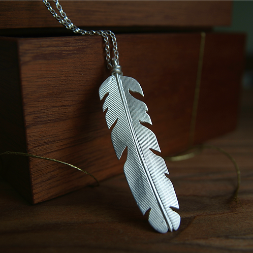 Feather Pendant with Close-Up of Textures