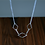 geometric silver necklace with rhombus shapes