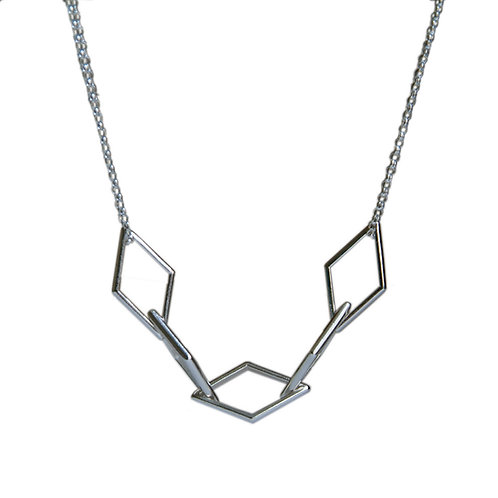 silver geometric shapes necklace on a white background