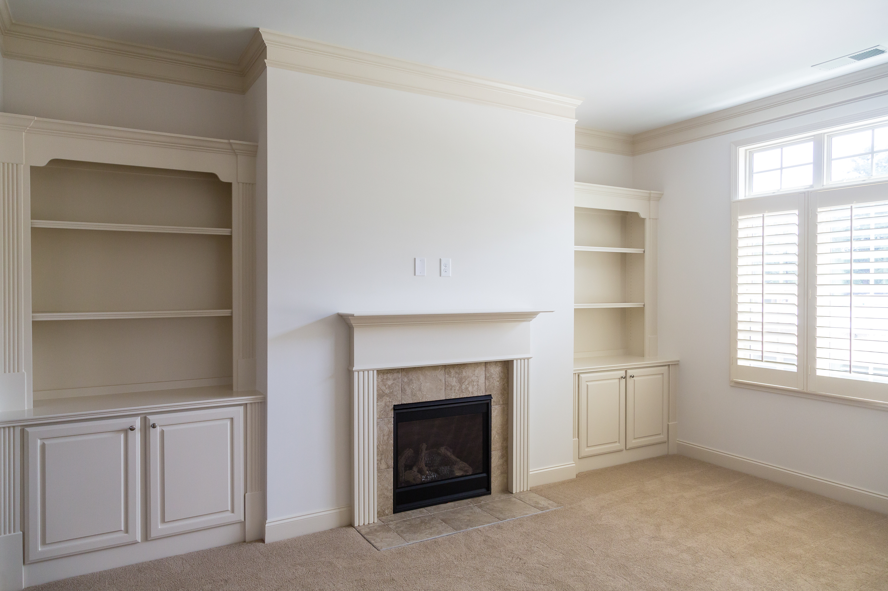 A new home with fireplace and builtin bookcases