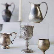 Assorted metal vases