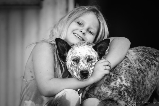 A Little Girl & Her Dog