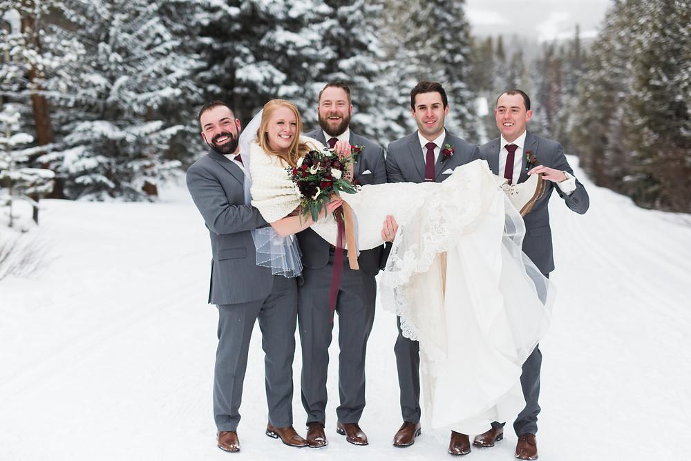 Bride and groomsmen at a wedding at the Breckenridge Nordic Center in Breckenridge, Colorado
