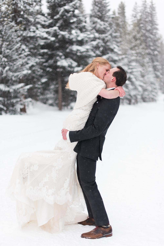 Bride and groom share a kiss at the Breckenridge Nordic Center in Breckenridge, Colorado
