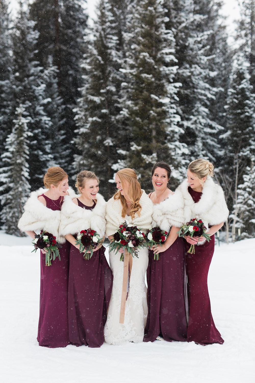 Bride and bridesmaids at a wedding at the Breckenridge Nordic Center in Breckenridge, Colorado