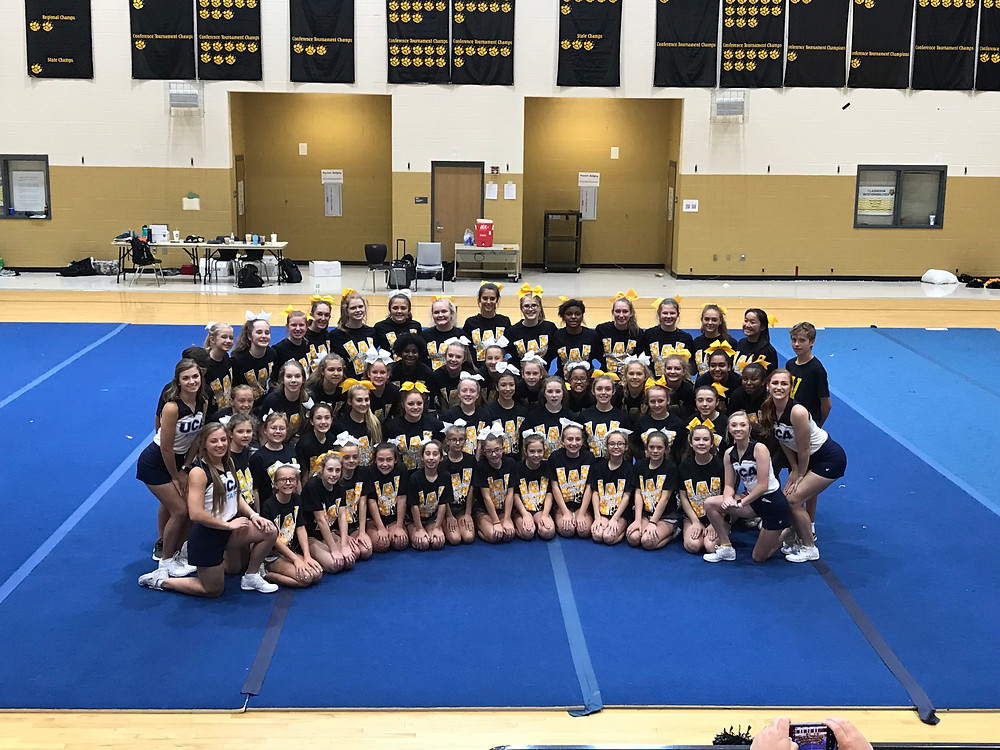 MEMBERS OF THE WOODFORD COUNTY CHEER TEAMS pose for a photo at the Universal Cheer Association camp. (Photo submitted)