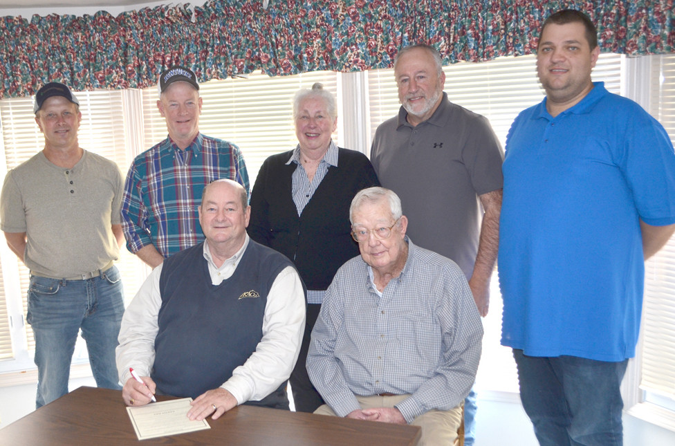 WCCD BOARD OF SUPERVISORS, back, from left, Donald Mitchell, Curtis Congleton, Peggy Carter Seal and Darrell Varner, with operations manager Jimmy Chambers; and front row, from left, Woodford County Judge-Executive John Coyle and Harold Carmickle, chair of the Woodford County Conservation District Board of Supervisors, during a recent proclamation signing for Earth Day. (Photo by Bob Vlach)