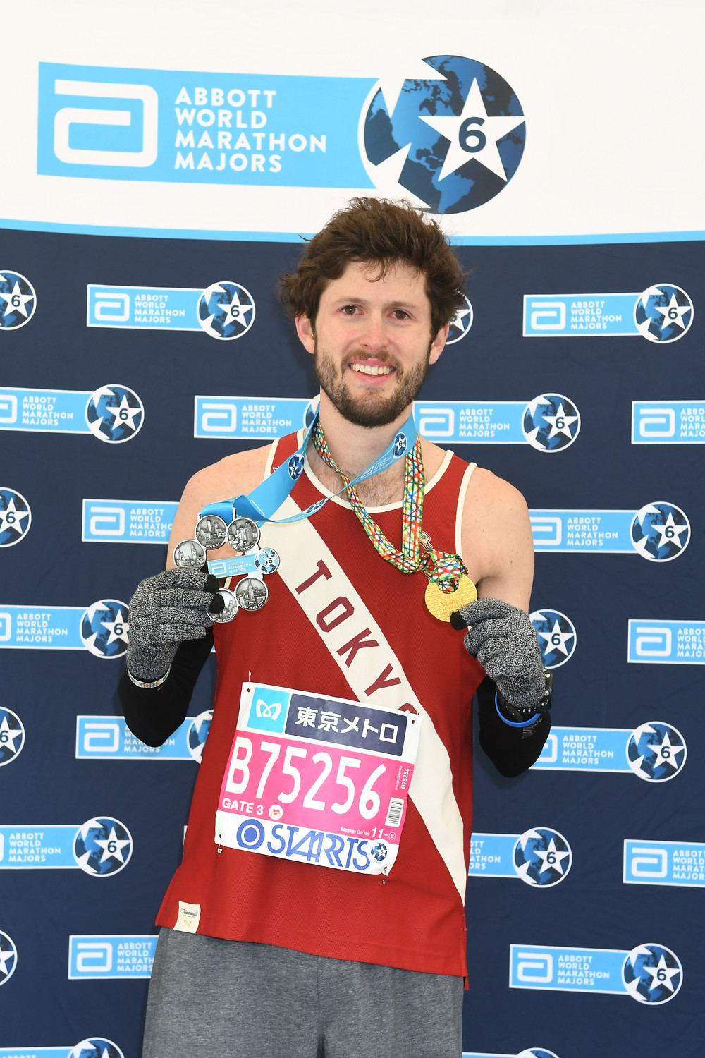 WOODFORD COUNTY NATIVE TED WERNER holds medals for completing the big six major marathons and the Tokyo marathon. (Photo submitted)
