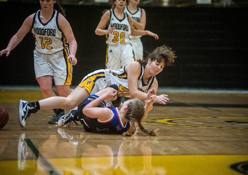 WCHS JUNIOR SAVANNAH KARBACH crashes to the floor after a collision with a Lady Patriot defender in a game played on Jan. 20. (Photo by Bill Caine)