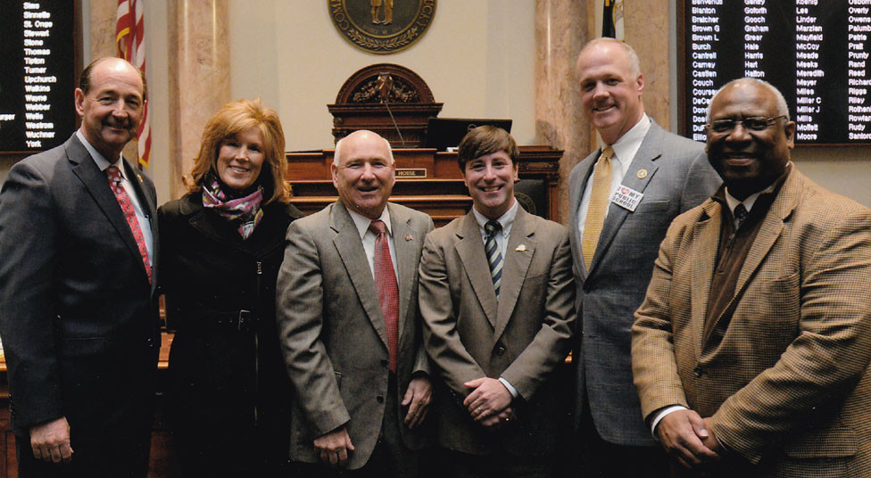 """A RESOLUTION IN THE HOUSE of Representatives on March 21 honored former U. S. Marshal and Woodford County Sheriff Loren """"Squirrel"""" Carl for the 40 years of service that he has given to law enforcement. From left are state Rep. Rocky Adkins, minority floor leader; Kelly Carl; """"Squirrel"""" Carl; state Reps. James Kay, of Versailles, Russ Meyers and Derrick Graham. (Photo submitted)"""