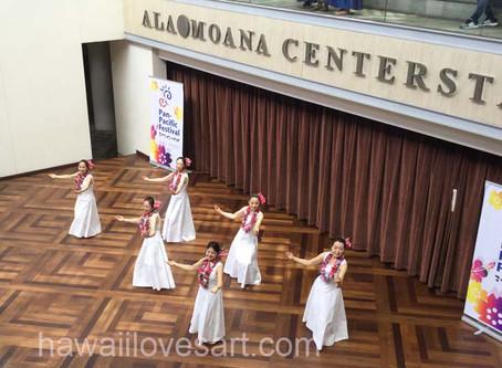 Japanese tourists do the hula in Honolulu