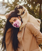 face-mask-mockup-of-a-woman-carrying-her