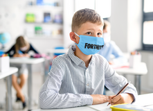 face-mask-mockup-featuring-a-boy-writing