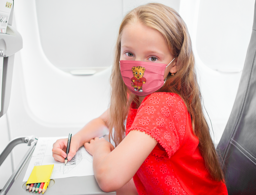 face-mask-mockup-of-a-girl-on-an-airplan